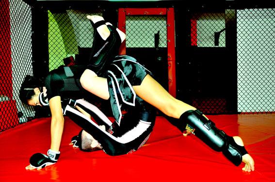 Kick Boxing Fashion: On top Sara wears black t-shirt by Shogun, boxing shorts by Raja, gloves by RDX, kick-boxing shoes by Leone; Emanuela  wears t-shirt by Bull Terrier, boxing shorts by MB by Maria Buccellati
