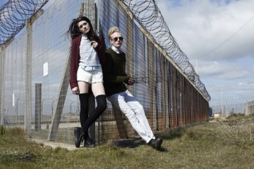 Lottie wears shorts by American Apparel, shoes by Office, cardigan is models own, shirt by American Apparel & striped top by Beyond Retro; Alex wears glasses by American Apparel, jumper by American Apparel, jeans by Topman, bootsby Beyond Retro & shirt by Burton