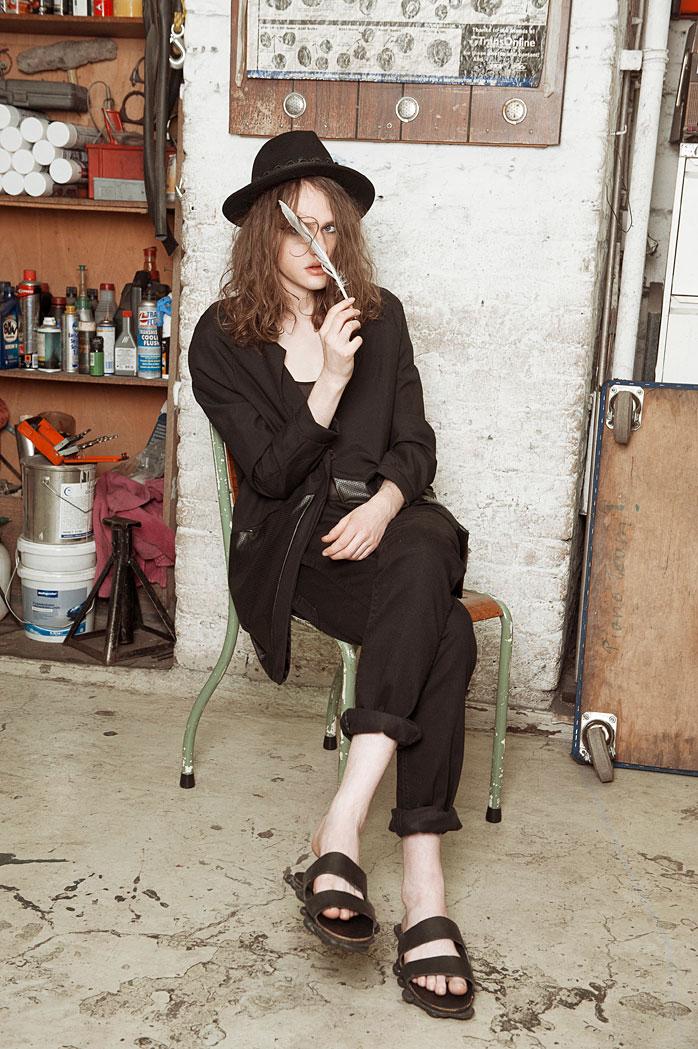 Rory wears hat by Augustin Teboul, jacket by Frisur, top by Cos, jeans by Wrangler, sandals by Julian Zigerli
