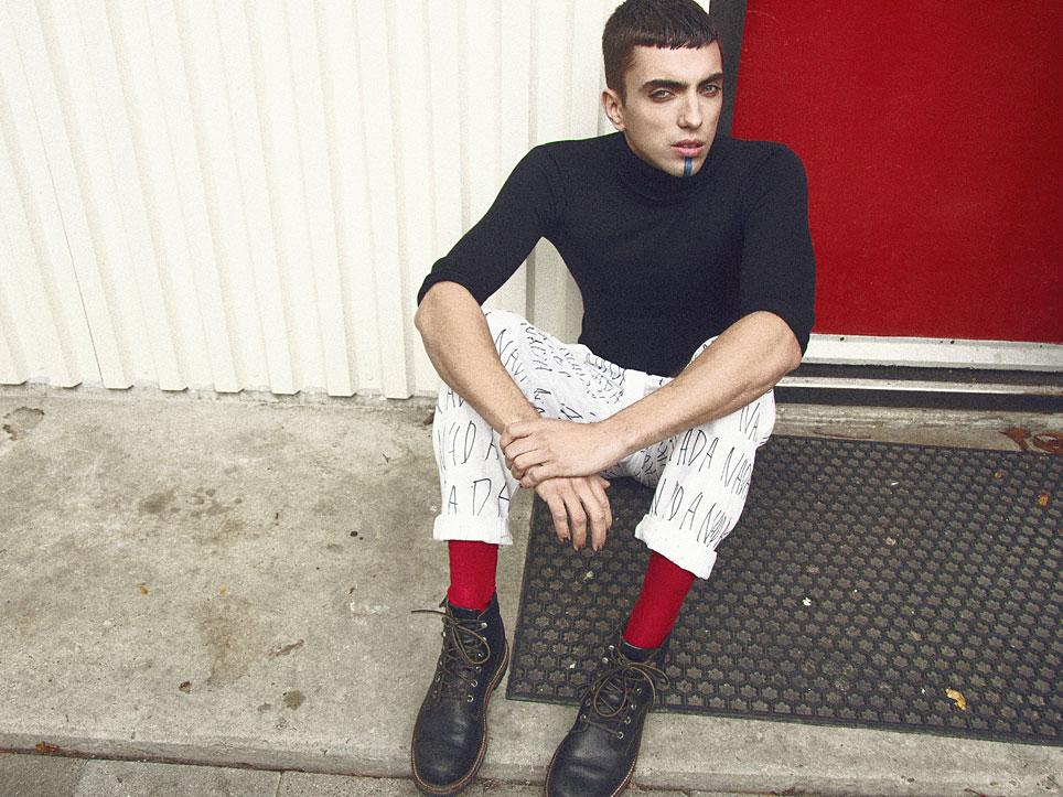 Clint wears top by Aziz Bekkaoui, trousers by Nada Van Dalen, red socks by Turner & Sons, boots by stylists own