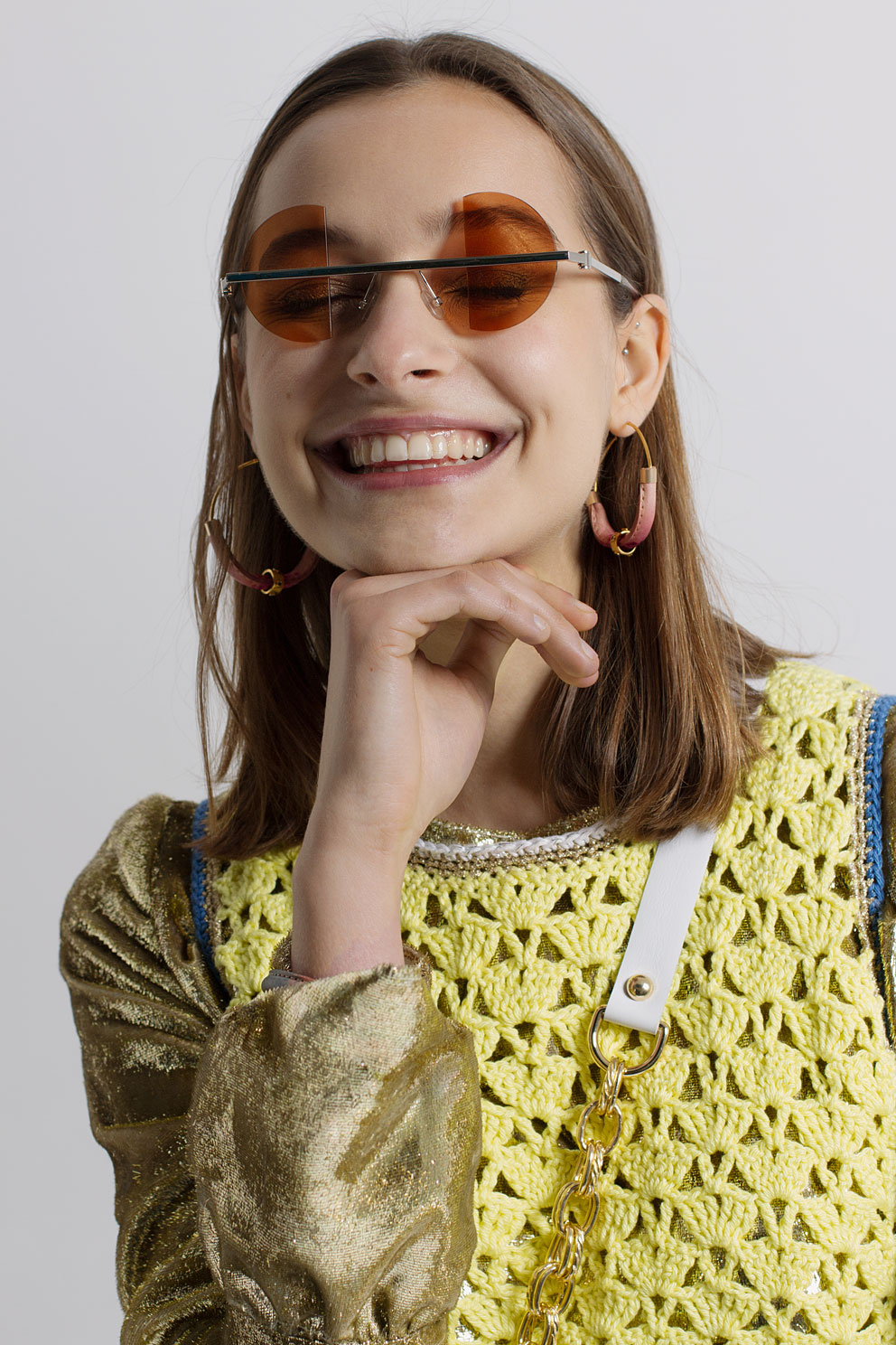 Gold long sleeve top by Ammerman Schlosberg, yellow knitwear crop by Katie Jones, earrings by Jacey Withers, glasses by Percy Lau, bag by Death in Paris