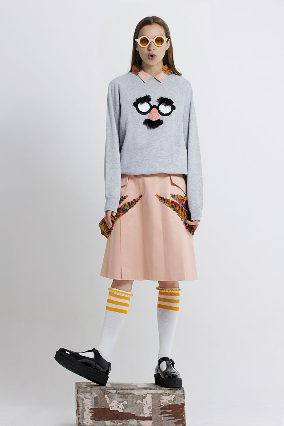 Pastel collar shirt by Gyoyuni Kimchoe, grey sweatshirt by Cat Brothers, pastel side ruffles skirt by Gyoyuni Kimchoe, shoes by Underground England, white tube socks by Cat Brothers, wooden frame yellow glasses by Termite Eyewear