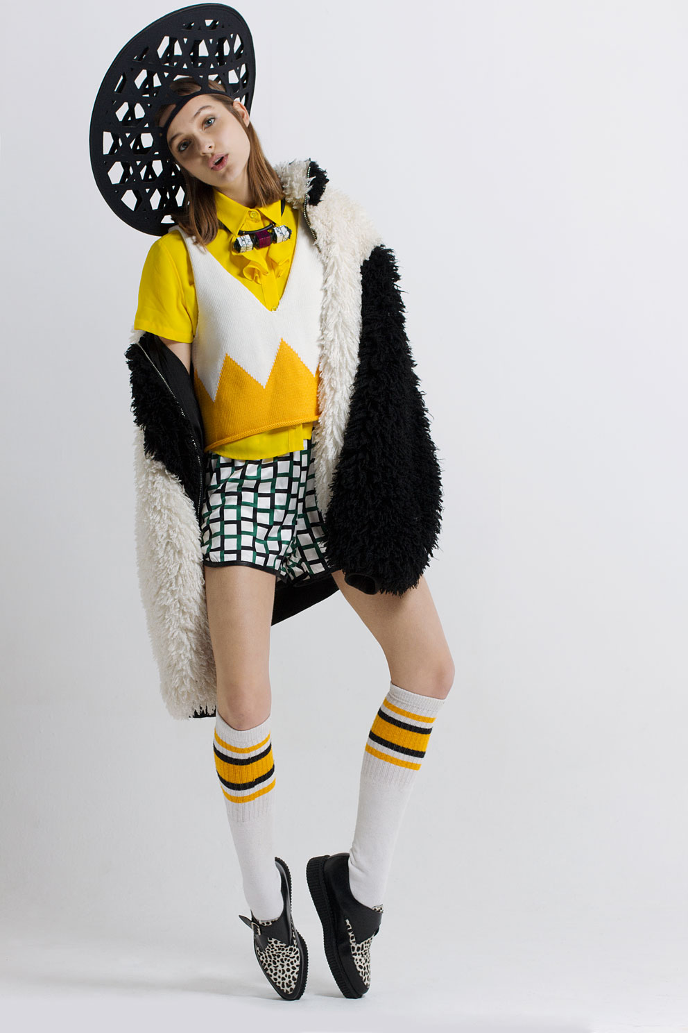 Yellow shirt by Peter Jensen, white & yellow knitwear sleeveless top by Cats Brothers, shorts by Cat Brothers, jacket by Hardware London, necklace by Lily Kamper, shoes by Underground England, hat by Awon Goldin