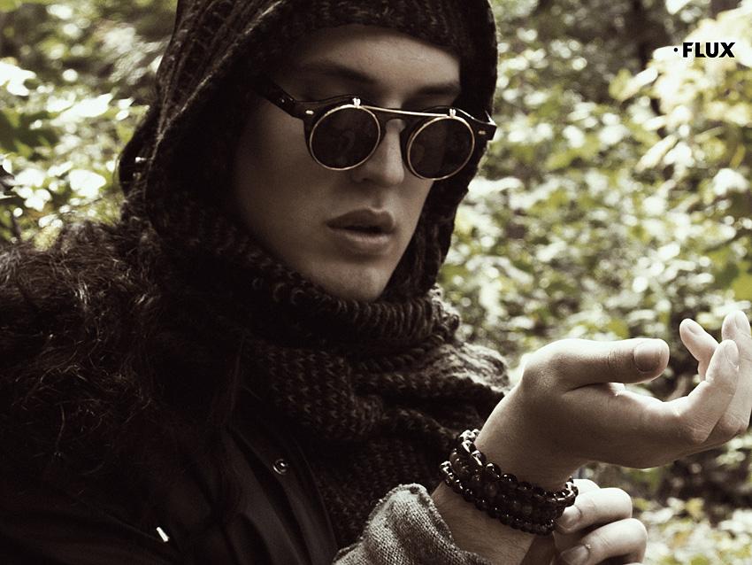 jacket RAINS, sweater MIKOLAJ KOCON, scarf DIESEL, sunglasses, feather and cross all VINATAGE, bracelets BLACK WOLF JEWELLERY