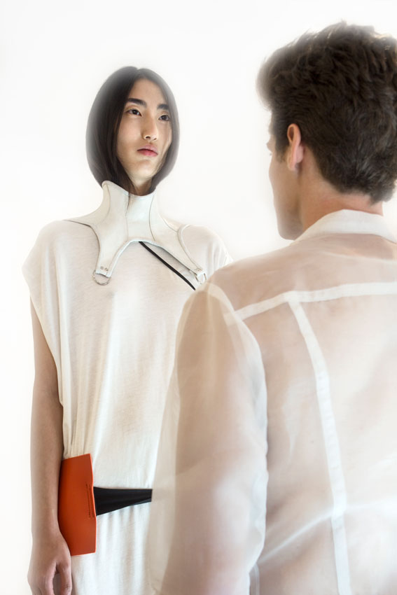 Je t'aime by Taner Tumkaya: Mark wears white sheer collar shirt by Genevieve Clifford.  Anita wears white shirt dress, necklace and orange & black belt by Harold Kensington, white neck panel by Mother of London