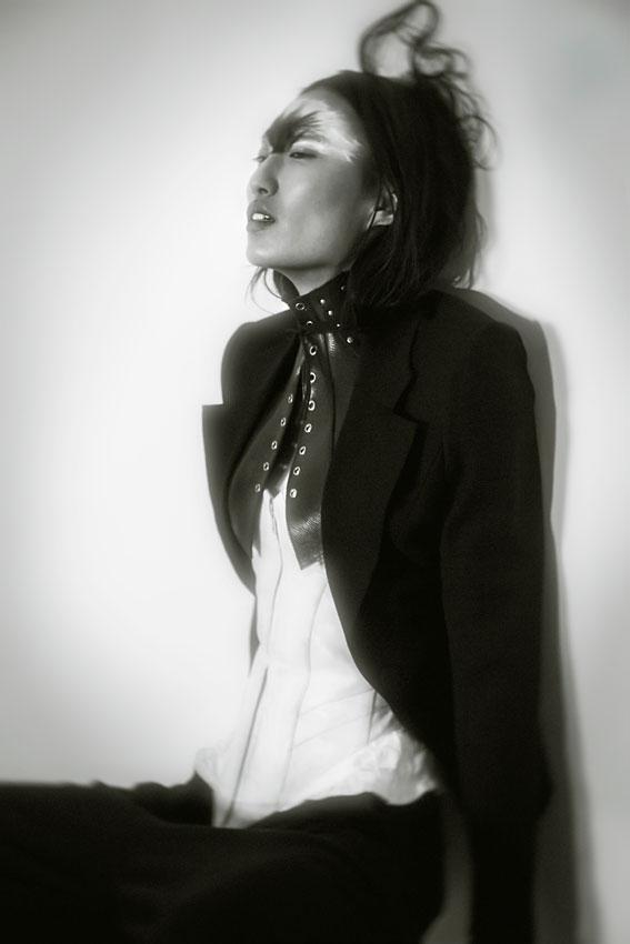 Je t'aime Taner Tumkaya: Anita wears blazer by Morris Hanks, harness by Mother of London, trousers by Harold Kensington