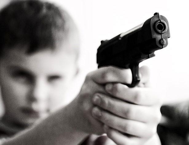 Baby wants a gun